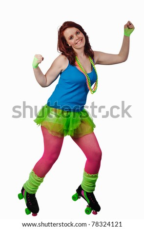 Roller girl. Young attractive woman dressed in 1980's style clothes and roller skates - stock photo