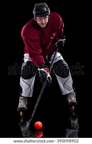 Roller hockey player. Studio shot over black. - stock photo