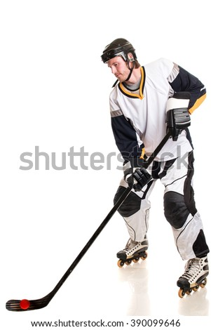 Roller hockey player. Studio shot over white.