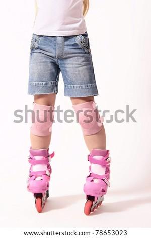 Roller skates on the skater legs. Driving on rollers. White background. - stock photo