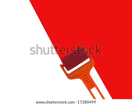 Roller with red paint - stock photo