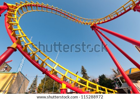Rollercoaster against blue sky in the evening - stock photo