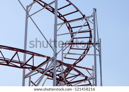 Rollercoaster against blue sky in the evening