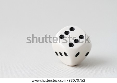 Rolling a white die showing 6, 3 and 2 - stock photo