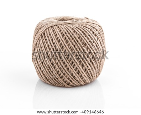 rolling ball of hemp rope on white background