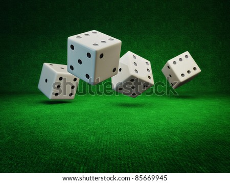 Rolling Dice on a green background isolated - stock photo
