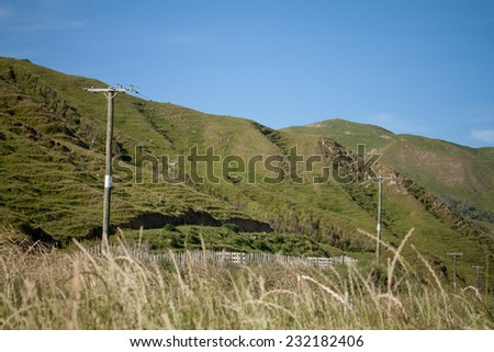 Rolling green hill country pasture land East Coast, North Island, New Zealand  - stock photo