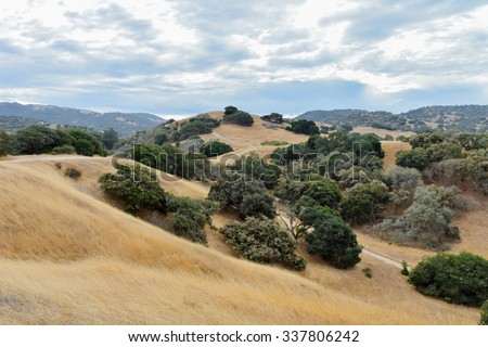 stock-photo-rolling-hills-with-coastal-l