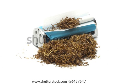 rolling machine tobacco and filter - stock photo