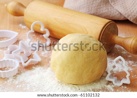 Rolling pin and shortcrust pastry on table - stock photo