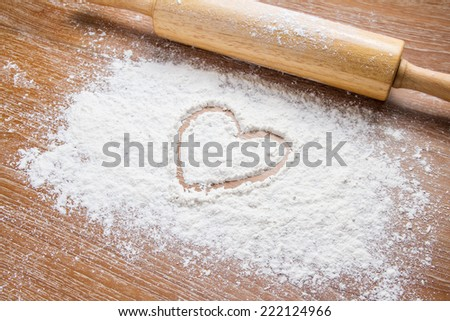 rolling pin on table with flour - stock photo