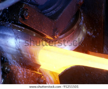 Rolling steel tube - stock photo