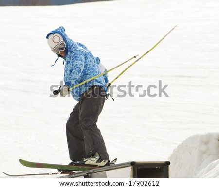 rolling young people in the snow-park at the health resort - stock photo