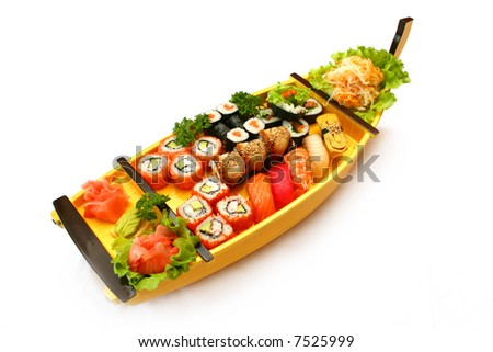 Rolls and sushi at the boat on white background - stock photo