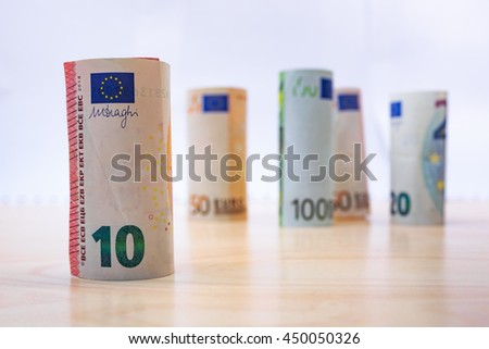 Rolls Euro banknotes. Euro currency money. Banknotes stacked on each other in different positions