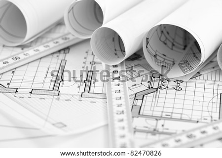 rolls of architecture blueprint, house plane & metric folding ruler - stock photo