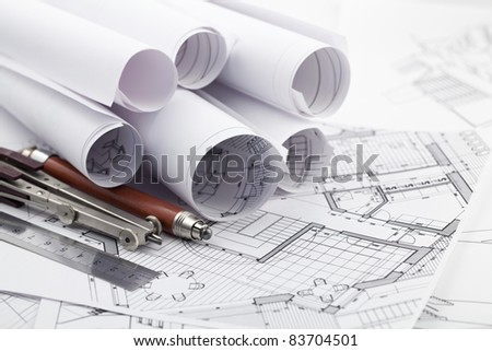 rolls of architecture blueprint & work tools - ruler, pencil, compass - stock photo