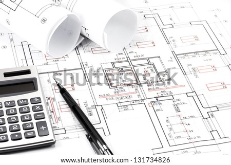 Rolls of architecture blueprints and house plans - stock photo