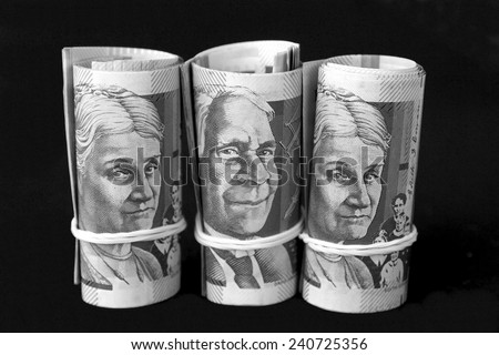Rolls of Australian Fifty Dollar Notes in black and white - stock photo