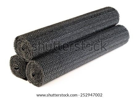 Rolls of black liners for shelves and drawers, white background