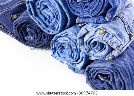 Rolls of Blue Jeans isolated on white background with copy space for your text - stock photo