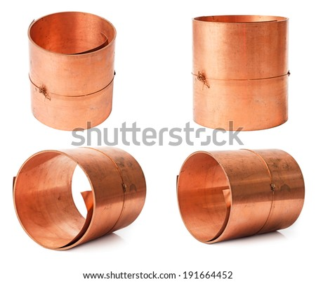Rolls of copper sheet isolated on white background - stock photo
