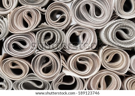 Rolls of newspapers stack. Latest news, journalism, power of the media, newspaper and magazine subscription and ads concept.  - stock photo
