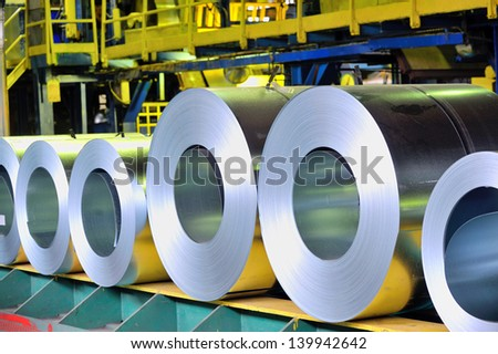rolls of steel sheet in a plant; galvanized steel coil - stock photo