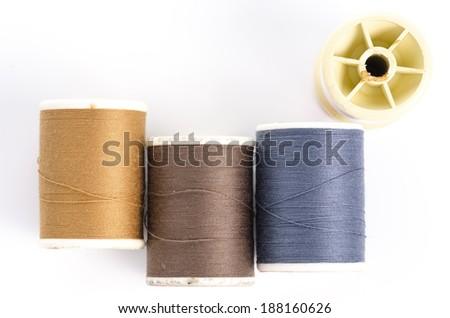 rolls of thread, bobbin of thread - stock photo