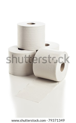 Rolls of toilet paper arranged on white background - stock photo
