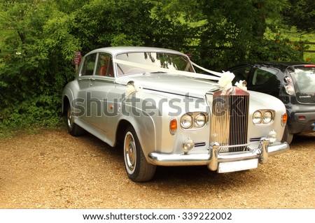 Rolls-royce English white luxurious wedding car in Stourhead, England. 05.30.2015 - stock photo