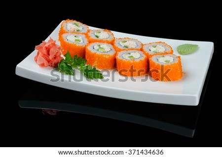 Rolls with flying fish caviar on white plate