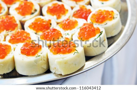 Rolls with salmon roe on a dish