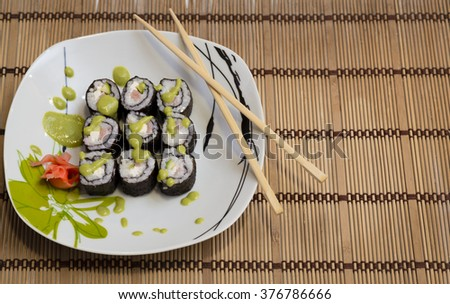 rolls with spicy tuna on a plate - stock photo