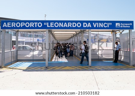 ROMA, ITALY - AUGUST 10, 2014:Crowd people, just stepped off the plane, in passageway for registration inside Leonardo da Vinci-Fiumicino Airport - largest airport in Italy  - stock photo