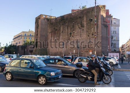Roma, Italy - November 11, 2014: Traffic in the center of Rome, Italy. The photograph was shot at the moment of red traffic light. - stock photo