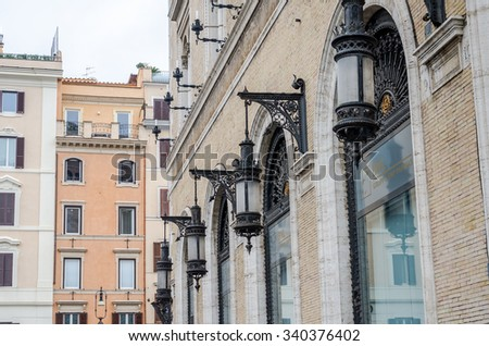 Roma, Italy - October 2015: Street vintage retro lights for illumination in the bank building in Rome Piazza Venezia - stock photo