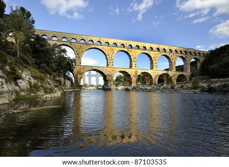 Roman aquaduct Pont du Gard, France at sunset. This is an Unesco World Heritage site
