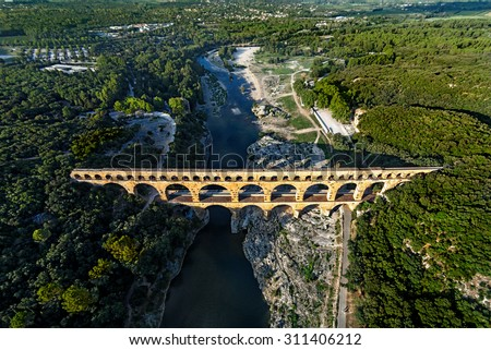 Roman aqueduct, Pont du Gard, Languedoc-Roussillon France, aerial view - stock photo