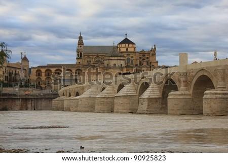 Roman Bridge and Mosque of Cordoba - stock photo