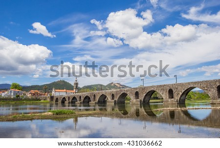 Roman bridge in Ponte de Lima, Portugal - stock photo