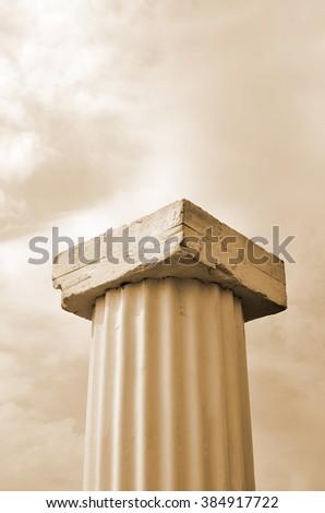 Roman column under a nice cloudy sky - stock photo