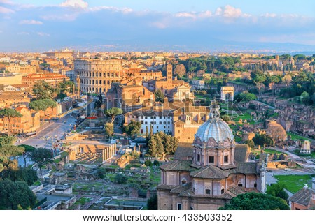 Roman Forum and Great Colosseum ( Coliseum, Colosseo, Flavian Amphitheatre ),at sunset time. Picturesque urban landscape. Aerial panoramic view on famous touristic landmark.Rome.Italy.Europe. - stock photo