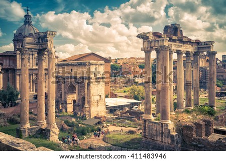 Roman Forum in Rome, Italy. Ruins of Temple of Saturn and Arch of emperor Septimius Severus. - stock photo