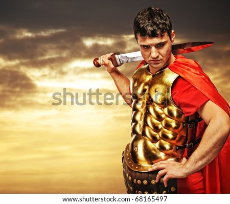 Roman legionary soldier against cloudy sky - stock photo