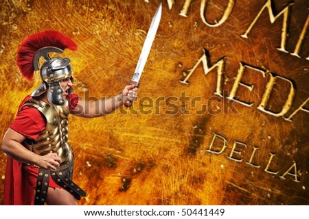 Roman legionary soldier in front of abstract background - stock photo