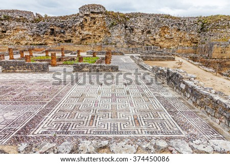 Roman ruins of Conimbriga. View of the House of the Swastika, the mosaics and Defensive Wall. Conimbriga, in Portugal, is one of the best preserved Roman cities on the west of the empire. - stock photo