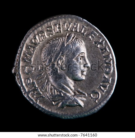 Roman Silver Coin - Alexander On A Black Background - stock photo