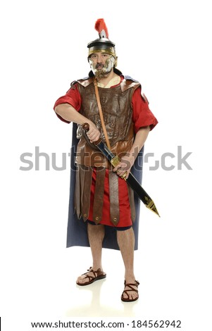 Roman soldier with sword standing up isolated on a white background - stock photo