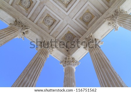 Roman temple Maison Carree in city of Nimes in southern France - stock photo